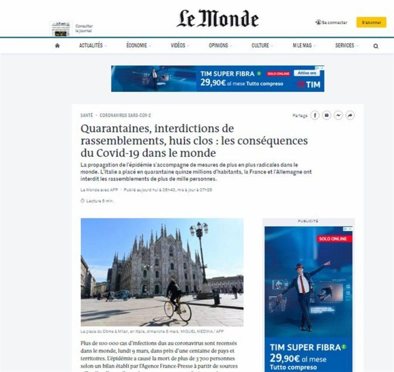 Le Monde e la foto simbolo dell'epidemia con il  Duomo di Milano sbarrato